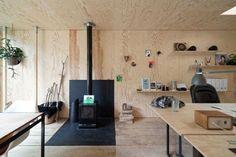 O que um estúdio de design enterrado esconde sob seu telhado verde