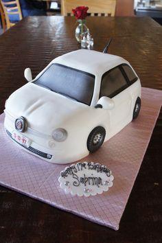 White Fiat shaped birthday cake