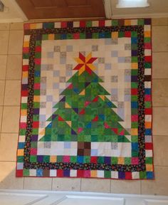 Name:  Christmas Tree quilt 2013.jpg  This just sparkles. I love it. I have scraps!!!!