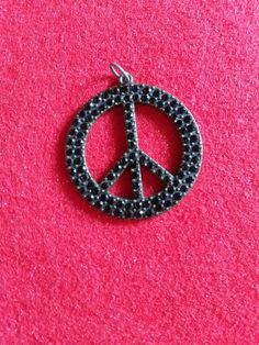 Black diamond bronze peace sign #newjewlz #hempjewlz #hemp #jewelry #pendant #metal #bronze #black #diamond #peacesign