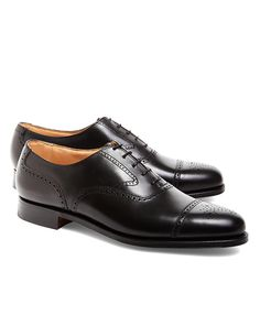 53755267d85 These men s medallion perforated captoe shoes are made of calfskin with a  leather lining and soles.