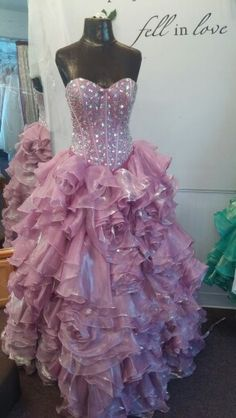 Gorgeous lilac ballgown with beaded top and rosette skirt #prom2016