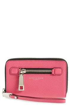Free shipping and returns on MARC JACOBS 'Gotham' Leather Phone Wallet at Nordstrom.com. With its oversized silvery hardware, grainy leather exterior and convenient wrist strap, this chic and spacious phone wallet will keep your essentials organized in style.