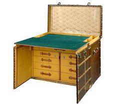 L.V. Malle Bureau (Desk Trunk). If you have the elephants, I'd bring tables instead.