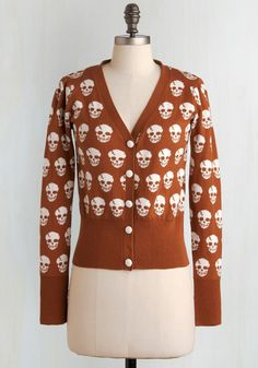Skulls in Session Cardigan in Burnt Sienna. If you're looking to break free from a ritual of wearing blas, uninspiring button-ups, the allover stylized skull print of this ribbed, V-neck cardigan could be your style antidote! #brown #modcloth