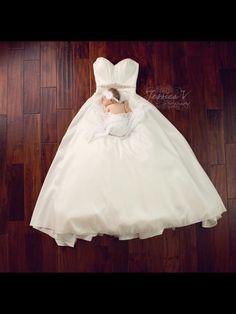 Baby girl and wedding dress