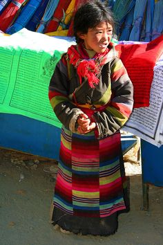 Little Seller of wind horses, Ganden monastery, Tibet