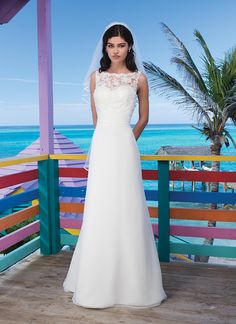 Sincerity wedding dress style 3778 Andros Attraction - Chiffon modified A-line features a corded lace Sabrina neckline and criss-cross pleated cummerbund. Style has illusion lace back enclosed by chiffon buttons and a court length train.