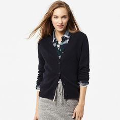 UNIQLO - Lambswool V-Neck Cardigan (Navy) This cardigan made with 100% lambswool combines warmth and comfort with feminine style.   An extra-long pre-wash gives it an extraordinarily soft texture. We updated the design with a straight, long silhouette and a narrow V-neck.   Specially processed to resist pilling. UNIQLO Jackets & Coats