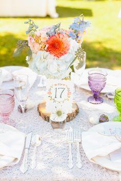 Wedding Centerpiece + Colorful Stemware! See more here: http://www.StyleMePretty.com/2014/03/27/whimsical-woodland-garden-wedding/ Photography: MasonAndMegan.com   Floral Design: MagnoliaDesignoc.com