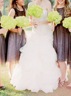 Amazing florals and dresses make up this seaside wedding | Read more: http://www.stylemepretty.com/alabama-weddings/2014/09/17/seaside-alabama-wedding-at-the-estuarium-at-the-dauphin-island-sea-lab/ | Photography: Jordan Brittley - http://jordanbrittley.com/