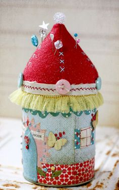 Make a pincushion from a can and deocrate with paper, felt & other embellishments.
