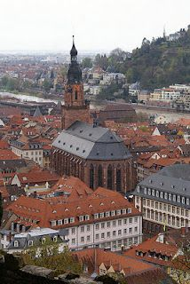 Heidelberg, Germany view from the tram. Church in the center has shops around the exterior.