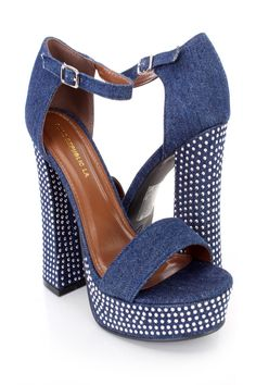 These sexy and stylish chunky heels include a blue denim fabric upper with an ankle strap and side buckle closure, strap vamp with an open toe, studded detailing, chunky heel, smooth lining, and cushioned footbed. Approximately 5 3/4 inch heels and 1 1/2 inch platforms.