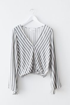 Long sleeve striped top with a flattering V neckline and bell sleeves. Fitted and elasticated bottom. Made with lightweight woven non-stretch material. Size sma