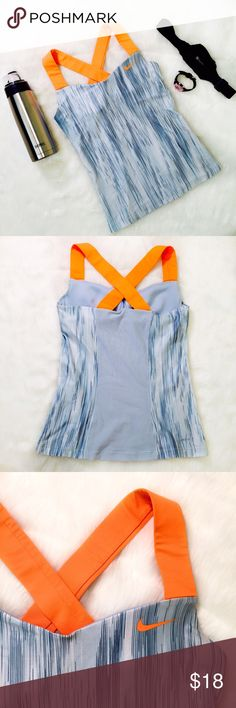 Nike Dri-Fit workout tank Various shades of blue print with neon orange straps that cris cross in the back. Has support unpadded bra. One small mark on inside of right bra, see 4th pic, not noticeable, other that it's like-new! Size S and bright colors. trade bundle for discount❣ Nike Tops Tank Tops