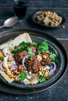 loaded lamb meatballs with eggplant hummus, yoghurt, pine nuts, coriander & mint