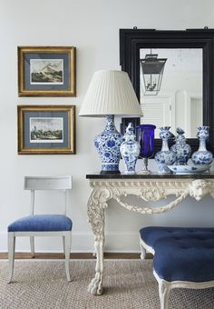 lovely blue and white vignette. The dark framed mirror is the perfect touch with all the blue and white.