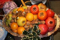 healthy fruits: khaki, apples, oranges, pomegranates and nuts