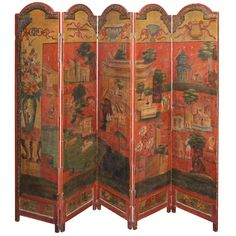 A 5 fold oil on canvas screen each panel with bracket feet and arched top decorated overall with figures in imagery landscape with architectural follies, pagodas etc. on a red ground.