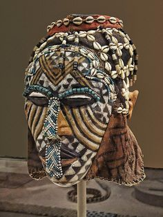 Mask (Ngady Amwaash) Kuba Kasai region Democratic Republic of Congo Late 19th - mid-20th century CE Wood pigment glass beads cowrie shells fabric and string