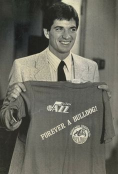 John Stockton displays a T-shirt presented to him when the Utah Jazz picked him in the 1984 NBA draft.