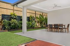 Patio with timber decking and beautiful landscaping.