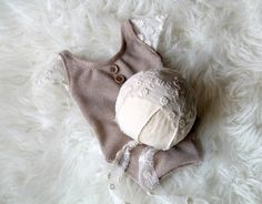 Newborn set in soft beige stretchy knit adorned with very delicate cream…