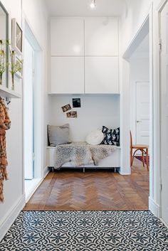 Flooring - beautiful herringbone pattern ... inspiration for tile in our entry area ...