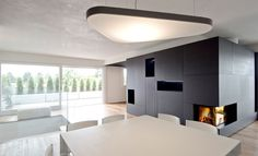MCZ fireplace in a black bookcase   yourFire   project of Made Associati, Treviso, Italy