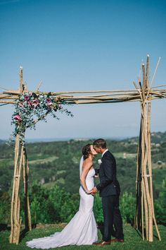 First kiss on a perfect day underneath their incredible DIY arch - it doesn't get more special than that! Courtney & Rhys' Summergrove Estate Wedding now live on the @cweddings1 blog <3 // Captured by the mega talented @sophiebakerfoto
