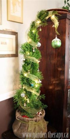Grinch Christmas Tree. I would decorate it a bit differently, but I love the tall, skinny, bent tree in the Grinch's sack... cute