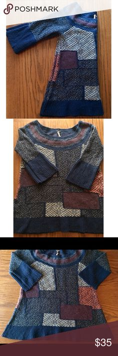 Free People Blue Patchwork Sweater Size small Free People patchwork sweater. Pilling at the end of sleeves and bottom of sweater but still in excellent condition. Tunic length with 3/4 flared sleeves. Free People Sweaters