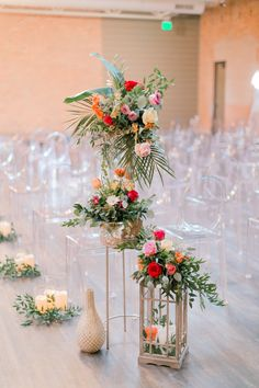 Stunning aisle end floral | summer wedding floral ideas | bright red, white, orange, pink with palm floral installation