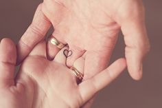 tattoo half a heart on each persons middle finger. put them together/hold hands to make a full heart. such a cute idea for  a couple.