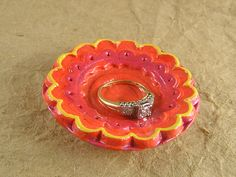 Bright fiesta ring bowl in shades of red, orange, and yellow by TheAmethystDragonfly, $25.00 USD