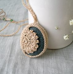 Crochet stone necklace, lace stone pendant by MariaKonstantin on Etsy. Handmade by me using a 1 1/2 x 1 1/4 smooth oval beach stone, the finest cotton thread in ivory and lots of love and attention to detail.    The stone is placed into the crochet setting and its decorated with a crochet lace ornament.    This stone necklace has very fine and thin crochet cord ties, so you can adjust the lenght of the necklace.    Thanks for visiting my shop