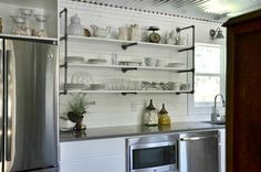 """We had to come up with ways to remodel our entire kitchen on a tight budget. Our new """"old"""" home is a 100 year old Craftsman. This kitchen has never seen a dishw… Galvanized Pipe Shelves, Galvanized Metal Roof, Kitchen Plinth, Kitchen Soffit, Dining Chair Makeover, Brick Paneling, Leather Wall, New Kitchen, Kitchen White"""