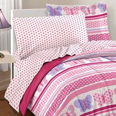 @Overstock.com - Butterfly Dots 7-piece Bed in a Bag with Sheet Set - This ultra-soft microfiber comforter set features a design of butterfly prints with bands of horizontal dots and stripes, reversing to a solid deep rose pink. A coordinating sheet set showcases a rose pink polka dot pattern.  http://www.overstock.com/Bedding-Bath/Butterfly-Dots-7-piece-Bed-in-a-Bag-with-Sheet-Set/8306554/product.html?CID=214117 $39.99
