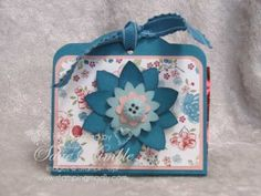 Here's a simple little Treat Holder made with my favorite Twitterpated Designer Series Paper. One of the great things about using Designer Series Paper is that Stampin' Up! has already figured out your color combination.  Then they provide the perfect embellishments, like the coordinating Twitterpated Buttons and Island Indigo Ruffled Ribbon.  www.stampingmadly.com
