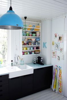 I do like the pops of color against the white.  I don't care for the black cabinet front.