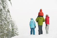 Family walk in the snow | 5 Reasons to Travel for Thanksgiving