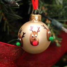 Use your child's thumbprint to make these keepsake reindeer Christmas ornaments