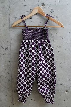 Use premade smocked material from fabric store. Maybe make short like summer outfits for little girls in 70-80's?