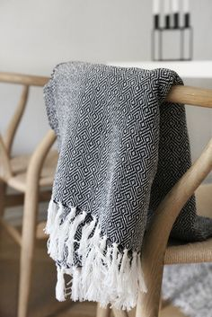 Cozy black and white woven throw. I want this so much love tasseled black and white throw and the light wood chairs