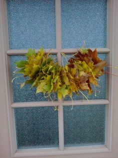 The easiest autumn leaf decoration ever :) Made by E 2 years