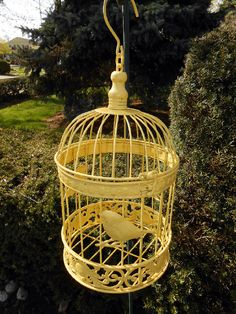 """Upcycled bird cage in canary yellow;  opens from the top; measures 13"""" H  X 8"""" in diameter; very attractive accent  piece for green room, great room, parlor  room; cotttage/shabby chic style; hangs  by hook; lightweight; can also be an  ornamental piece for a bedroom!"""