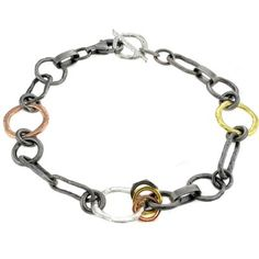 Oxidized silver, silver, brass and gold fit together in the most perfect symmetry. Bjørg rules.