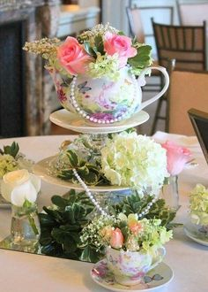 floral centerpiece at this Romantic Tea Party themed Bridal Shower / http://www.himisspuff.com/tea-party-bridal-shower-ideas/2/
