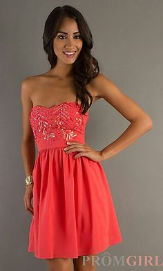 Knee lenth with no straps and has a bit of a lase in the top part of the dress. I'd say it is a redish pink.